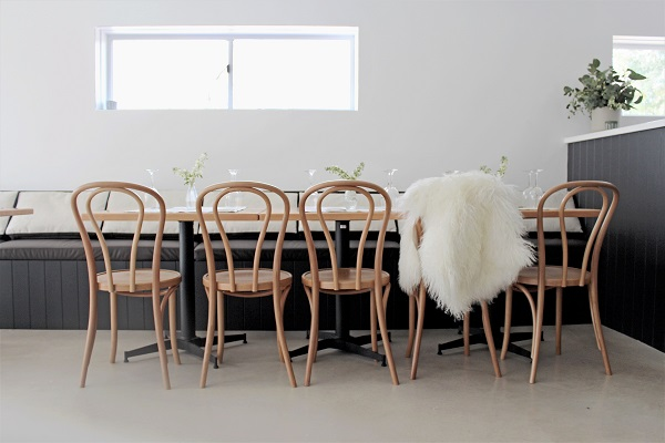 One x One Interiors Stockman's Ridge Cellar Door Interior Design Orange NSW. Acoustics solved with upholstered seating.